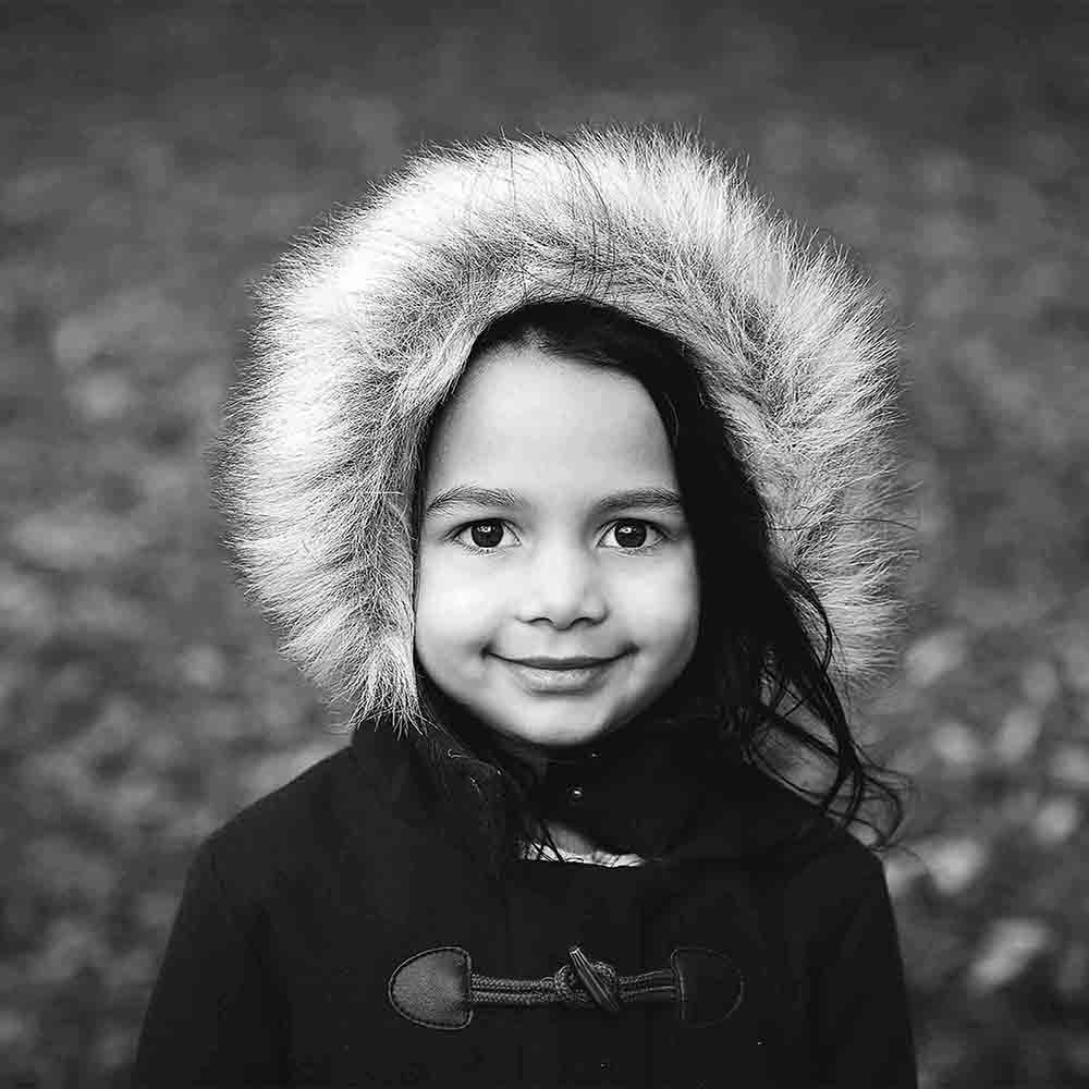 child in fur lined hood by Foxbelle Photography